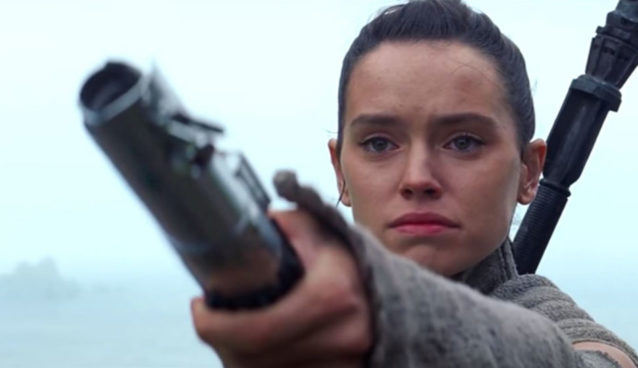 Rey with Luke's lightsaber in Episode 7